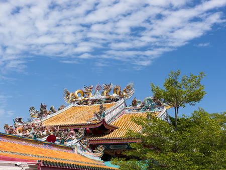 Chinese dragon statue on roof Stock Photo