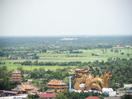 Big dragon with city view, landmark of Suphanburi Thailand photo