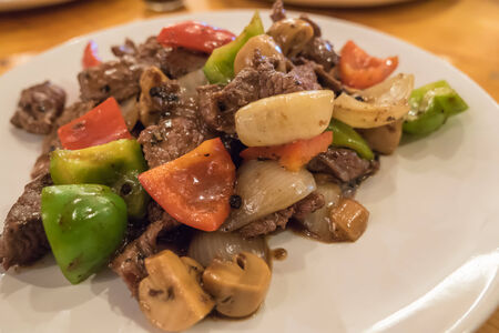 pepe nero: Ostrich stir-fried with black pepper sauce and mushroom Archivio Fotografico