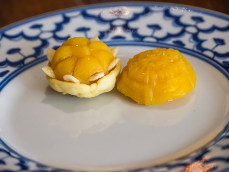 egg  yolk: Wheat flour dumplings with egg yolk and sugar, traditional Thai sweetmeat on plate, Stock Photo