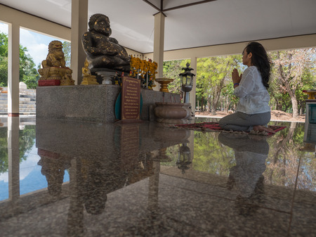 venerate: Thai woman pay homage to Buddha statue Editorial