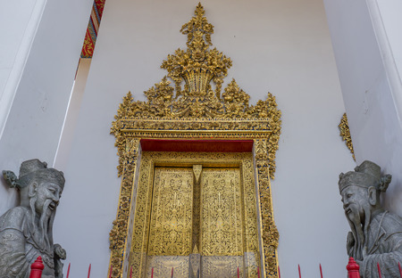 Chinese giant statue and traditional door in Pho temple, landmark in Thailand photo