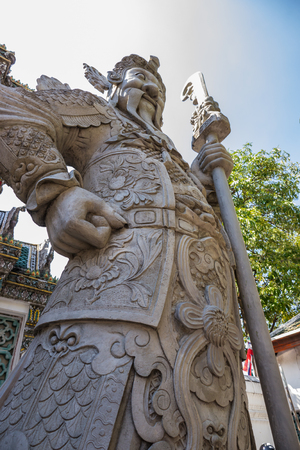 gardian: Chinese giant statue in Pho temple, landmark in Thailand Stock Photo