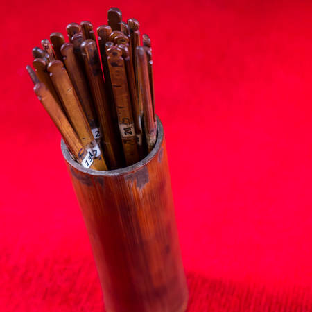 foretell: Fortune wooden sticks with number in bamboo box to predict the future