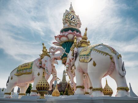king of thailand: Elephants statue lift lotus to praise King of Thailand, Grand palace, landmark in Thailand Stock Photo