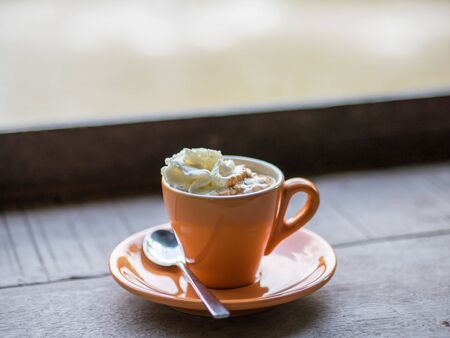 Cup of hot coffee with whipped cream