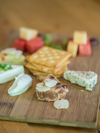 Variety cream cheese with biscuits and fruit salad