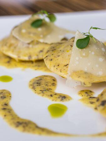 Ravioli in creamy truffle sauce