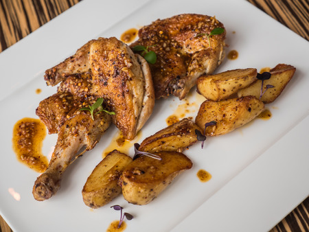 Grilled chicken and potato with spicy sauce
