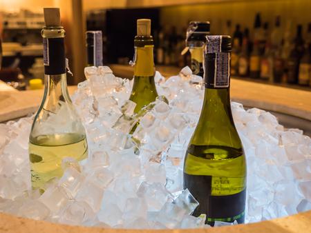 Bottles of wine in ice bucket