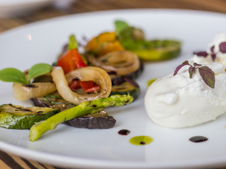 Mixed vegetable antipasto marinated with mint and burrata cheese