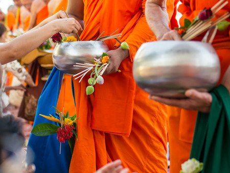 Offer sacrifice flowers to Buddhist monk