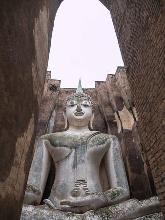 Ruin ancient Buddhist temple, Wat Si Chum Sukhothai, landmark in Thailand