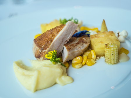 Cooked guinea fowl with mashed potato, corn, roasted almond Stock Photo