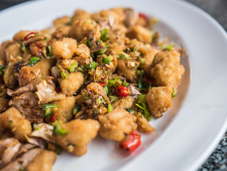 Fried crab meat with spicy herb Stock Photo