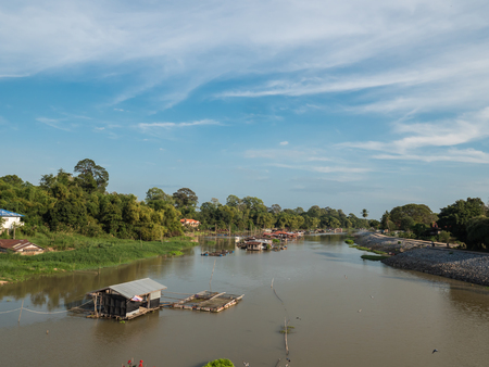Traditional houseboat on natural river in Uthaithani, Thailand