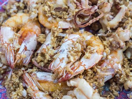 Fried prawn and squid with crispy garlic Stock Photo