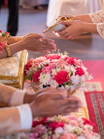 Thai wedding, watering conch ceremony