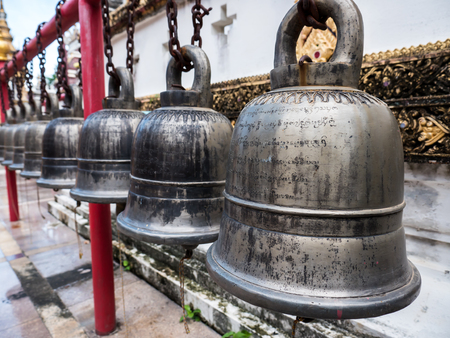 Ancient bell in Buddhist temple in Thailand