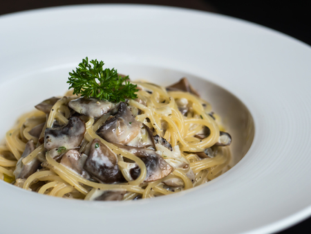Spaghetti white cream sauce with mushroom on plate Stock Photo