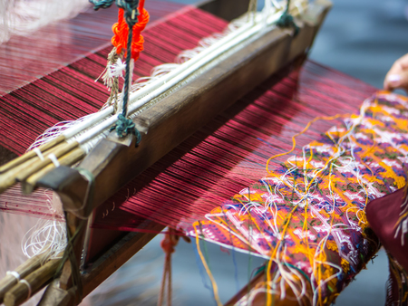 Weaving handicraft cloth with local apparatus