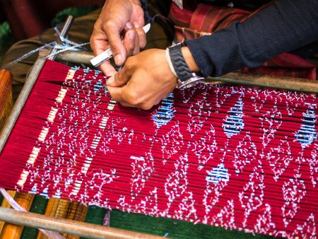 Thai local artist is making pattern of handicraft product Stock Photo