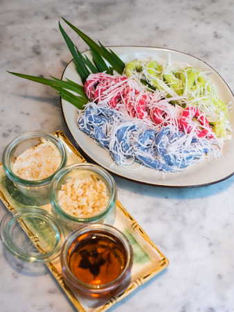 Thai traditional sweetmeat, kind of sweetmeat made in the shape of vermicelli Stock Photo