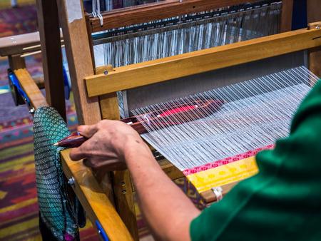 Weaving local apparatus demonstration to make Thai cloths handicraft Standard-Bild - 116177504