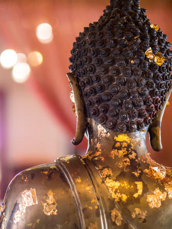 Back of Buddha statue in Thai temple