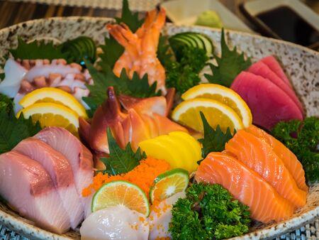 Mixed fresh sashimi set with wasabi and shoyu sauce Stock Photo