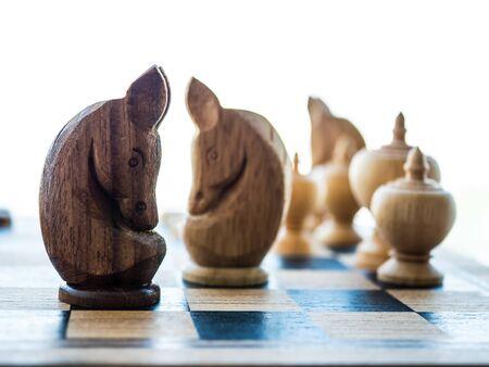 Thai wooden chess on checker chess board