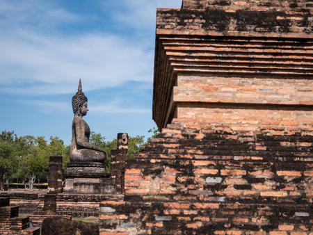 Ancient Buddha statue in Sukhothai historical park, landmark in Thailand Editorial