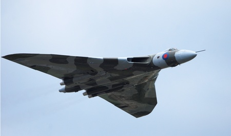 Vulcan Bomber flying from left to right on blue sky background Editorial