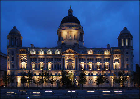 Port of Liverpool Authority. Building shown lit at dusk.