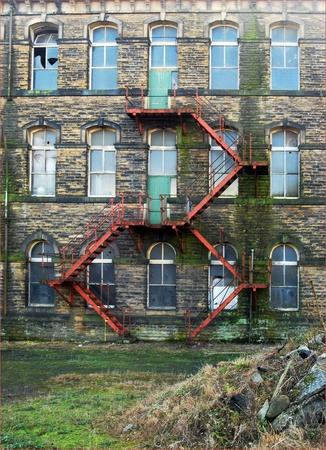dilapidation: Detail of a derelict factory building in West Yorkshire UK Editorial