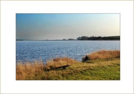 contemplates: Lone Fisherman contemplates reservoir.