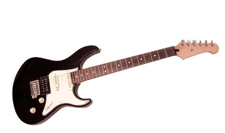 A black and white six string electric guitar with three pick ups isolated on a white background. Stock Photo