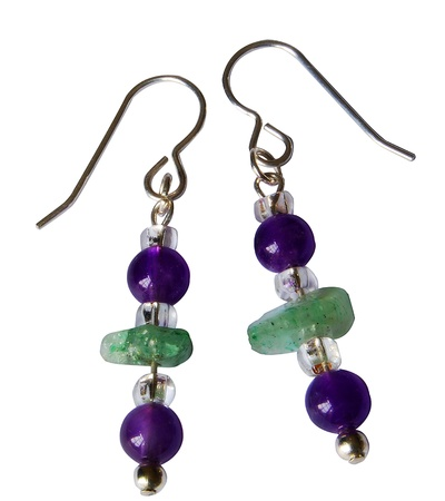 A pair of gorgeous custom made pendant earrings, featuring amethysts and river glass, isolated on a white background.