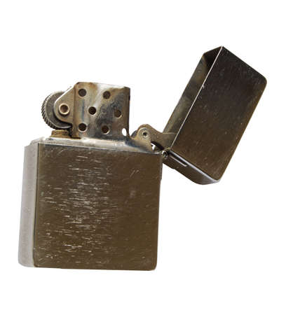 A well used classic flip top American cigarette lighter derived, so it Stock Photo