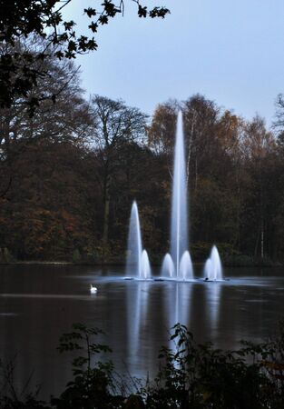 Fountain at the Upper Lake Roundhay Park Leeds. Seen at twilight.Long Exposure. Stock Photo