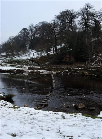 Stepping Stones Across the River Wharfe at Bolton Abbey in North Yorkshire.