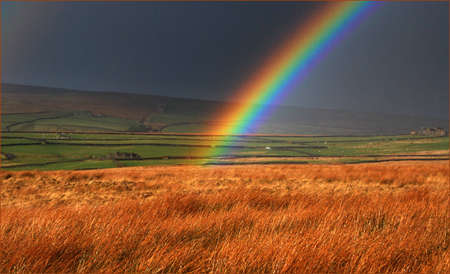 Part of a strong rainbow over moorland in Yorkshire.