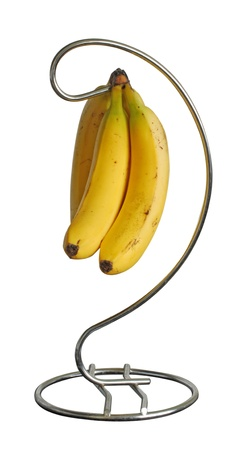A bunch of three ripe bananas on a stand. Isolated on a white background.