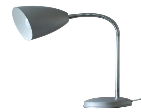 A silver coloured adjustable metal desk lamp with traditional bulb isolated on a white background