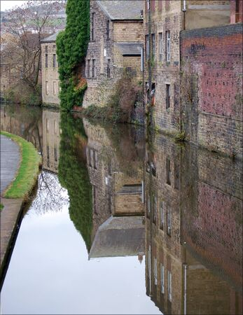 Canalside Buildings Reflected In Calm Water At Shipley West Yorkshire