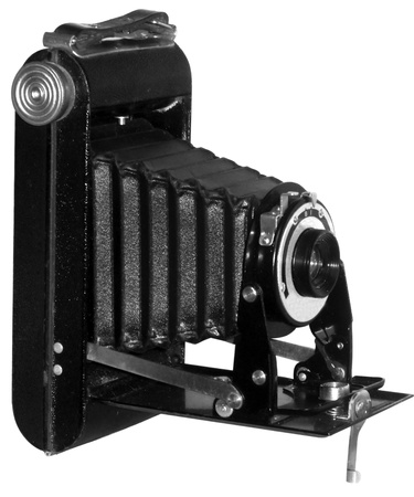 folding camera: A 1920s vintage film camera isolated on a white background. Stock Photo