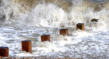 Incoming tide at a Kentish beach  Stock Photo