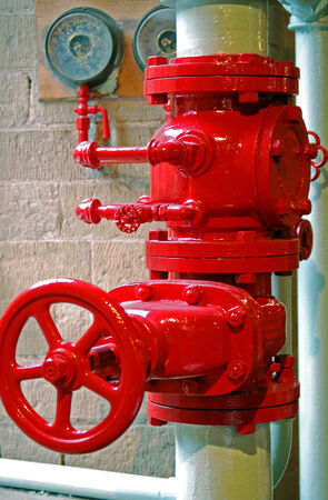 A lovingly restored bright red steam gate valve  Stock Photo