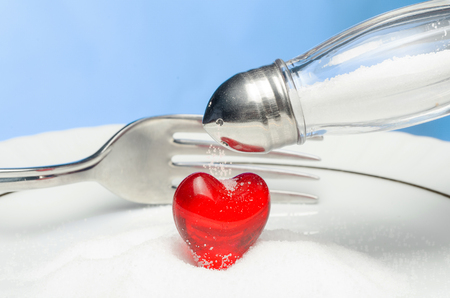 hypertensive: Do not throw salt in your heart. Stock Photo