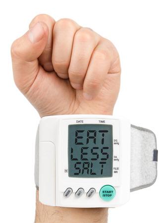 blood pressure monitor: Eat Less Salt Digital blood pressure monitor Stock Photo